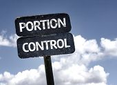 Portion Control sign with clouds and sky background