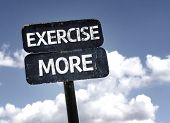 Exercise More sign with clouds and sky background