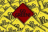 Go Green! written on multiple road sign