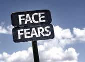 Face Fears sign with clouds and sky background