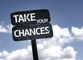Take Your Chances sign with clouds and sky background