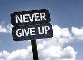 Never Give Up sign with clouds and sky background