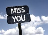 pic of miss you  - Miss You sign with clouds and sky background  - JPG