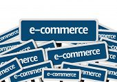 E-Commerce written on multiple blue road sign