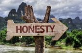 Honesty wooden sign with a forest background