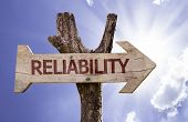 Reliability wooden sign with sky background