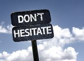 Don't Hesitate sign with clouds and sky background