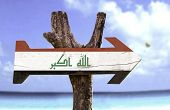 Iraq wooden sign with a river on background
