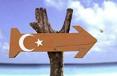 Turkey wooden sign with a beach on background