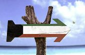 Kuwait wooden sign with a beach on background