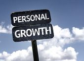 Personal Growth sign with clouds and sky background