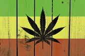 pic of rasta  - Rasta Flag With Marijuana Leaf on wooden background  - JPG