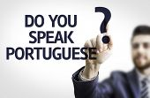 Business man pointing to transparent board with text: Do you Speak Portuguese?