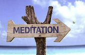 Meditation wooden sign with a beach on background