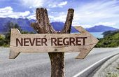 stock photo of repentance  - Never Regret wooden sign with a paradise on background - JPG