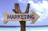 Marketing sign with a beach on background