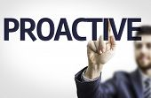 Business man pointing to transparent board with text: Proactive