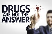 Business man pointing to transparent board with text: Drugs are not the Answer