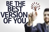 Business man pointing to transparent board with text: Be The Best Version Of You
