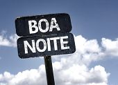 Good Night (In portuguese) sign with clouds and sky background