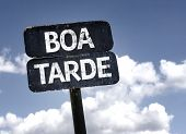 Good Afternoon (In portuguese) sign with clouds and sky background