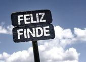 Happy Weekend (In Spanish) sign with clouds and sky background