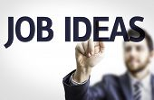 Business man pointing to transparent board with text: Job Ideas