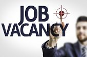 Business man pointing to transparent board with text: Job Vacancy