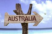 Australia wooden sign with a beach on background