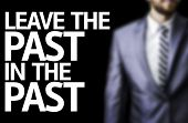 Leave the Past in the Past written on a board with a business man on background