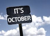 Its October sign with clouds and sky background