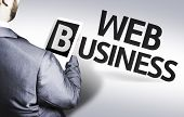 Business man with the text Web Business in a concept image