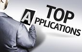 Business man with the text Top Applications in a concept image