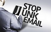 Business man with the text Stop Junk Email in a concept image