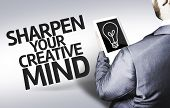 Business man with the text Sharpen your Creative Mind in a concept image
