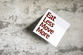 Eat Less Move More on Paper Note with texture background