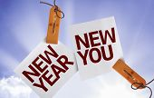 image of new year 2014  - New Year New You on Paper Note on sky background - JPG