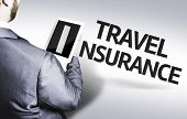Business man with the text Travel Insurance in a concept image