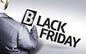 Business man with the text Black Friday in a concept image