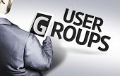 Business man with the text User Groups in a concept image