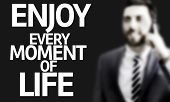 Business man with the text Enjoy Every Moment of Life in a concept image