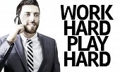 Business man with the text Work Hard Play Hard in a concept image