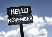Hello November sign with clouds and sky background