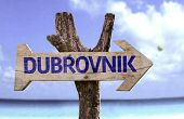 Dubrovnik wooden sign with a beach on background