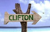 Clifton wooden sign with a beach on background