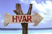 Hvar wooden sign with a beach on background