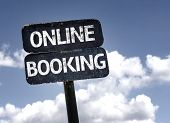 Online Booking sign with clouds and sky background