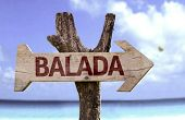 Party (In Portuguese) wooden sign with a beach on background