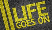Life Goes On written on the road