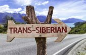 Trans-Siberian wooden sign with a railway on background